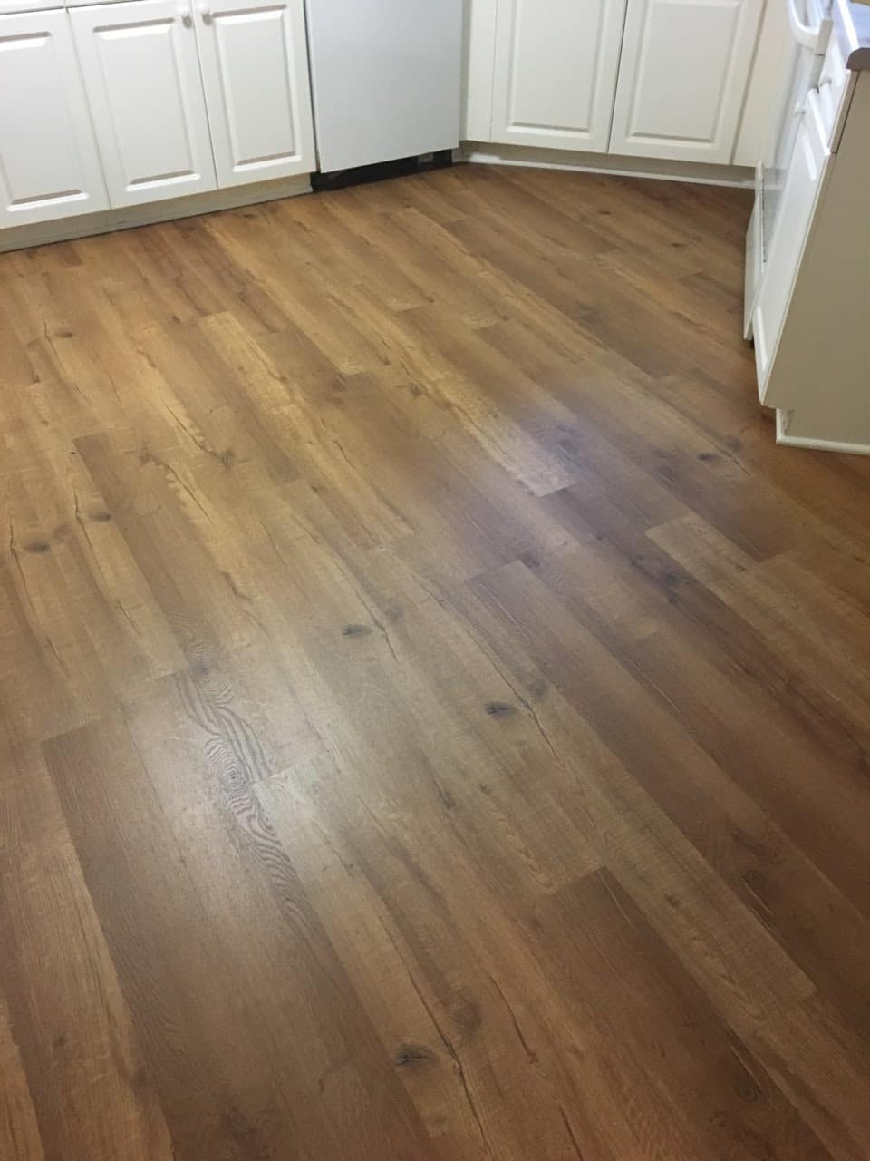 Luxury Vinyl Plank Lvp Installed In The Kitchen This Color Is Called American Ginger